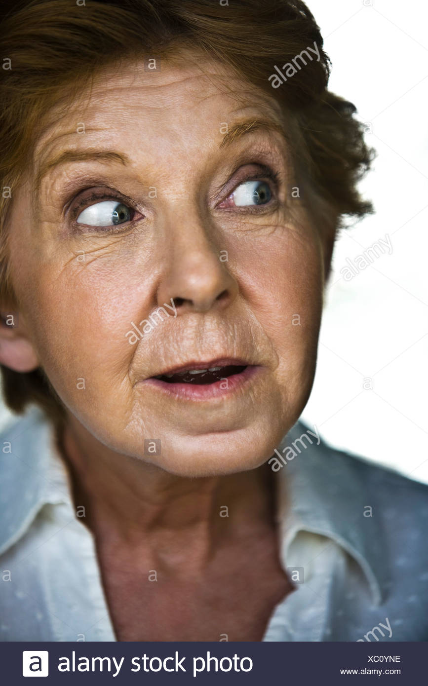 Senior woman displaying look of surprise - Stock Image