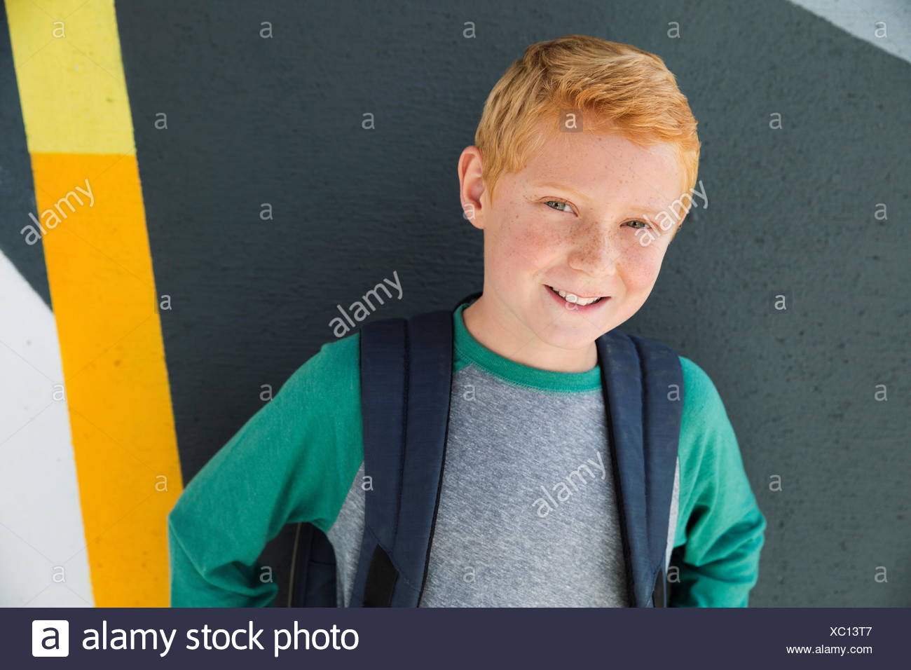 Portrait confident schoolboy with red hair - Stock Image