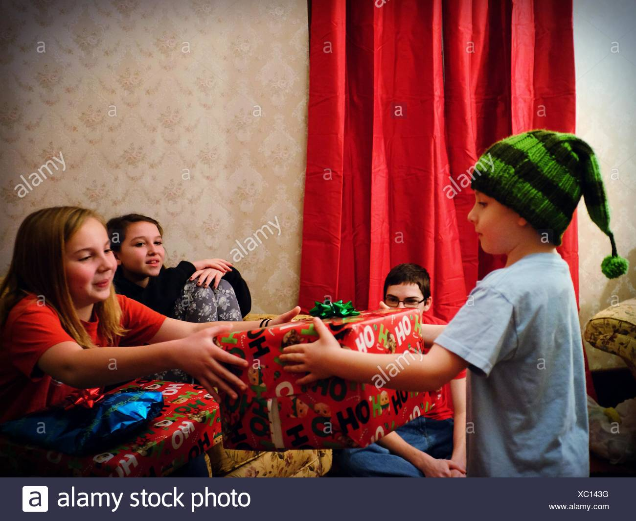 Children Giving Gifts - Stock Image