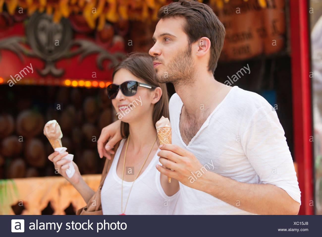 Couple eating ice creams, Paris, Ile-de-France, France - Stock Image
