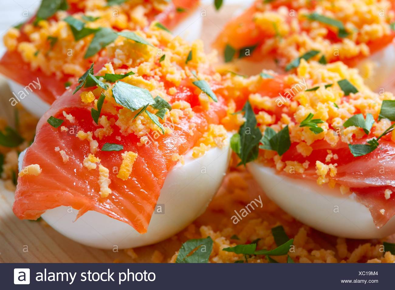 Filled eggs with salmon pinchos tapas from Spain recipes pintxos. - Stock Image