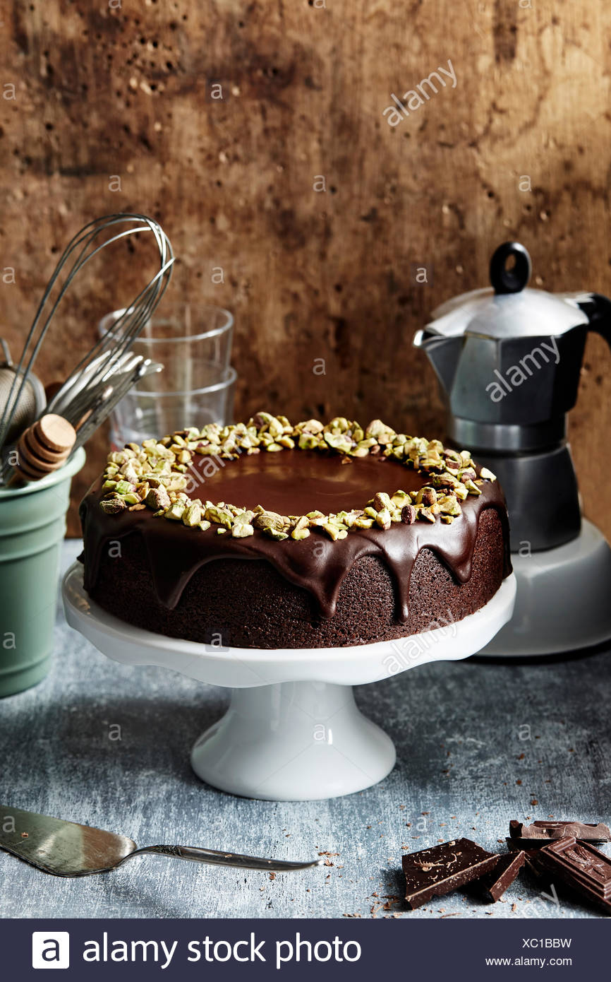 Chocolate frosted cake with chopped pistachios - Stock Image