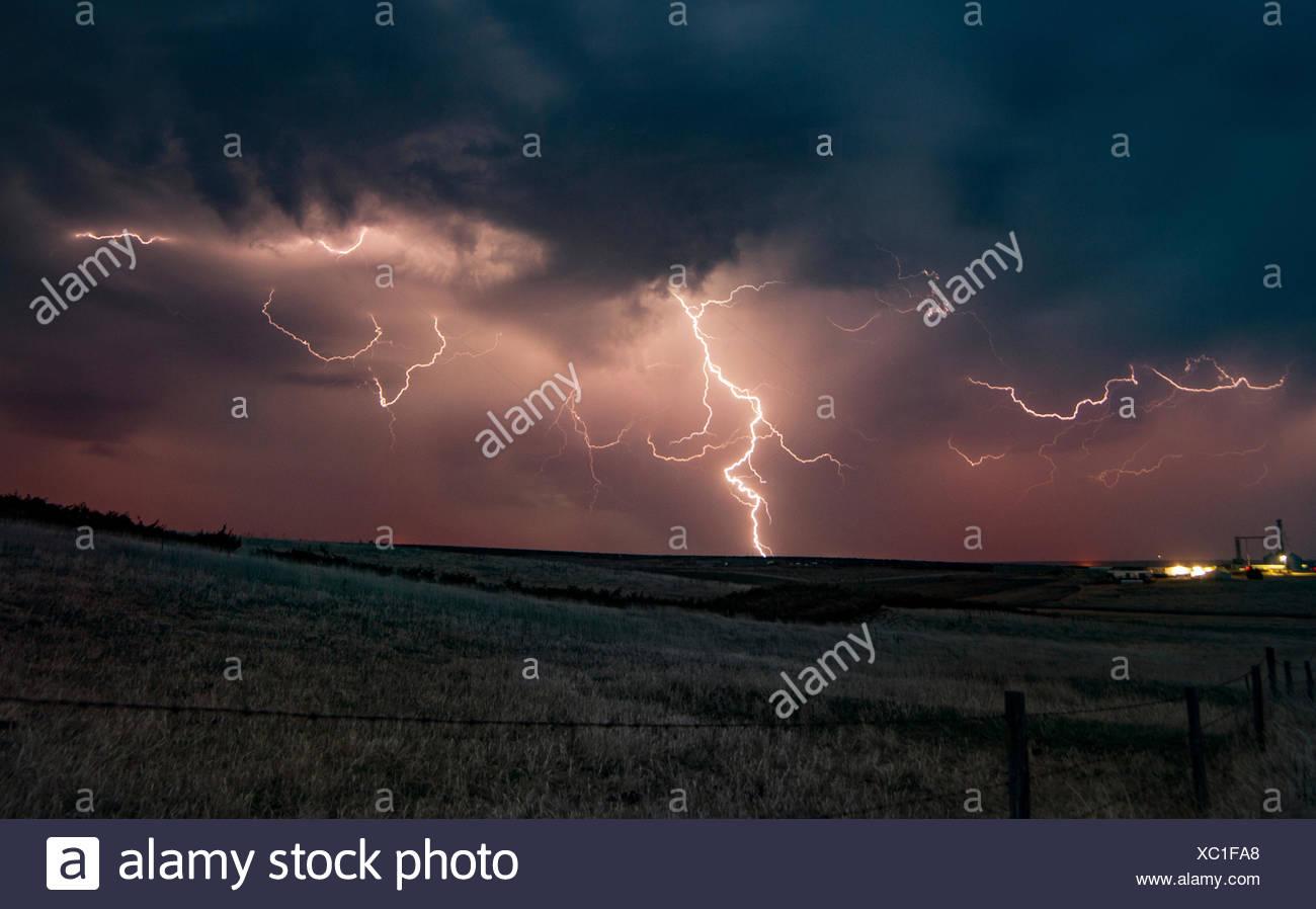 Forked lightning in orange sky over rural area Grant Nebraska United States & Forked Lightning Stock Photos u0026 Forked Lightning Stock Images - Alamy