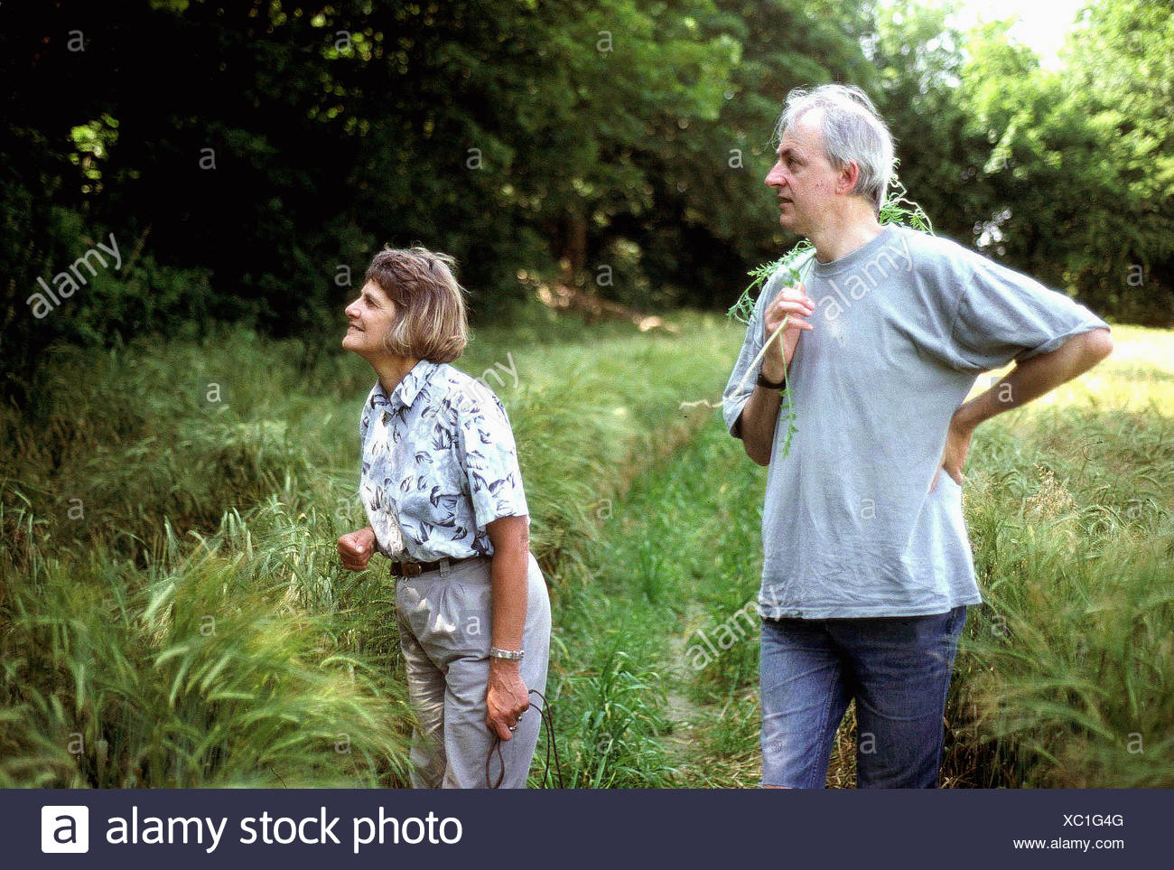 elderly couple on a country walk - Stock Image
