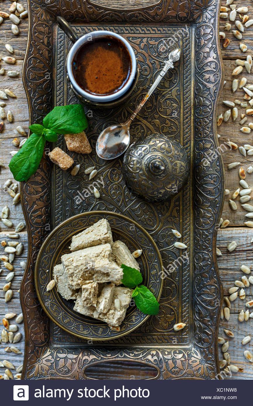 Black coffee and halva from sunflower. - Stock Image