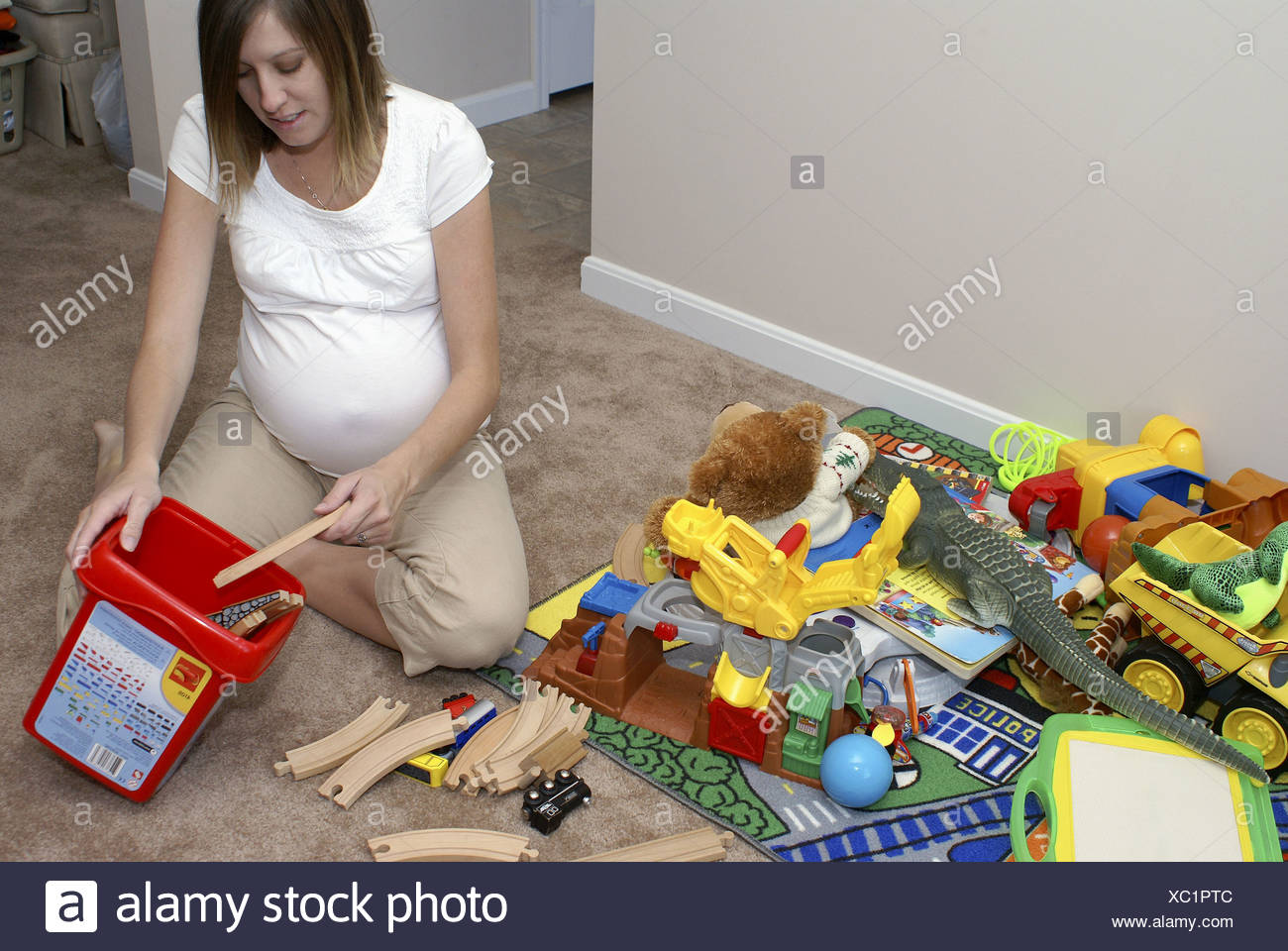 Children Putting Toys Away