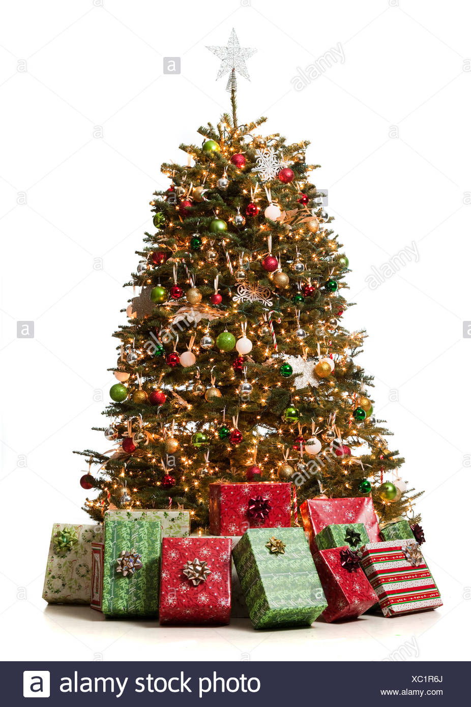 christmas tree with presents underneath it - Stock Image