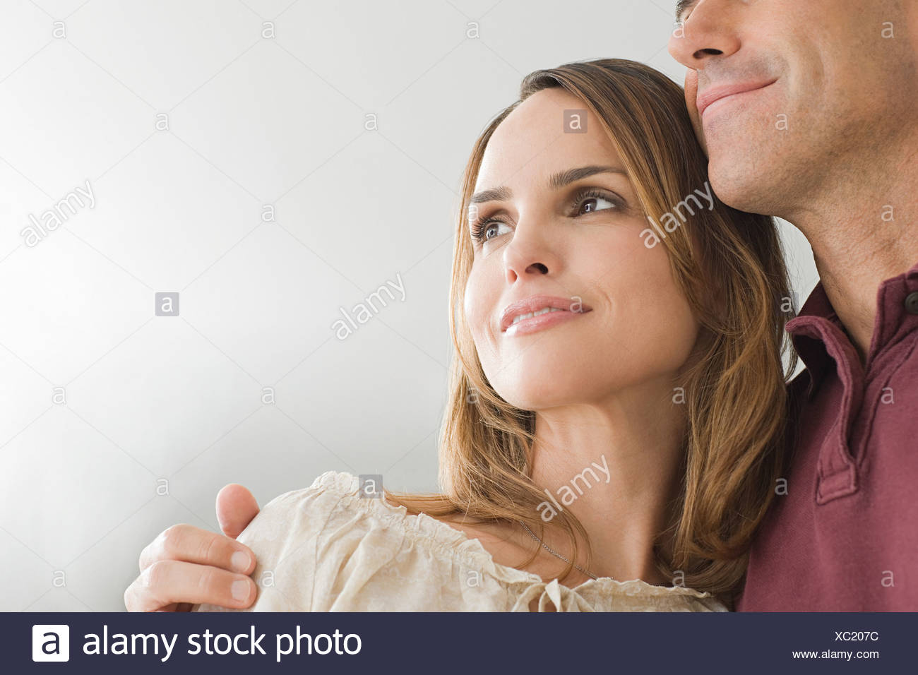 Man with his arm around his wife - Stock Image