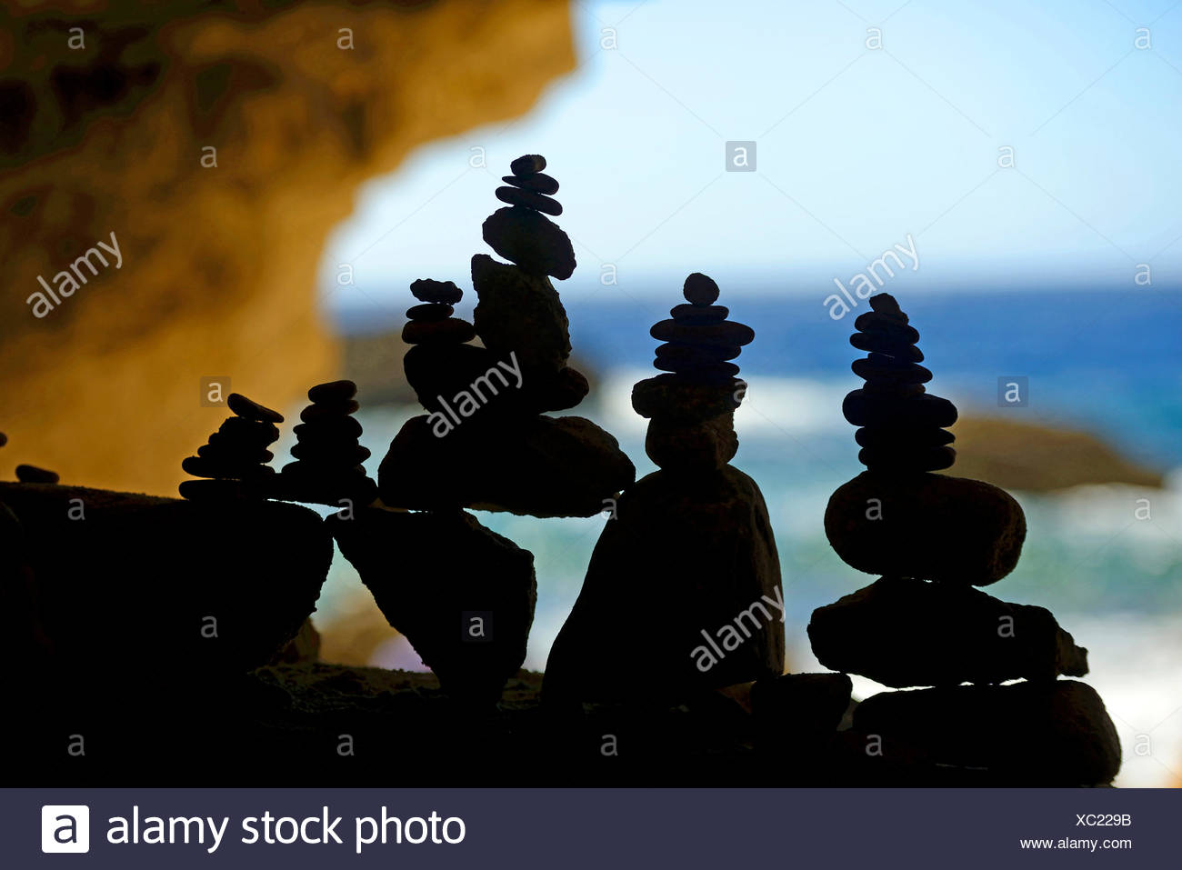 cairns in the shadow at the rocky coast, France, Corsica, Bonifacio - Stock Image