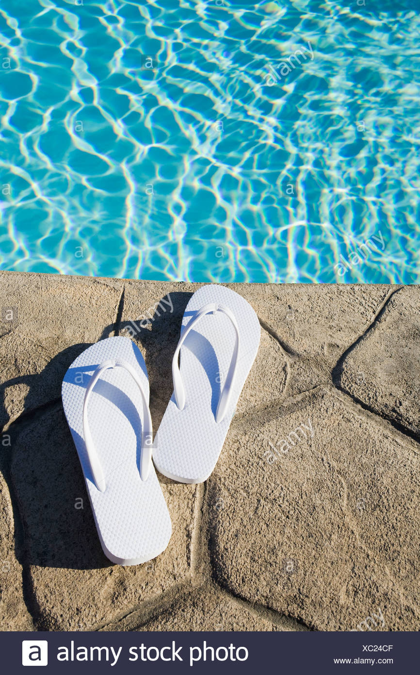 Flip flops by the pool - Stock Image
