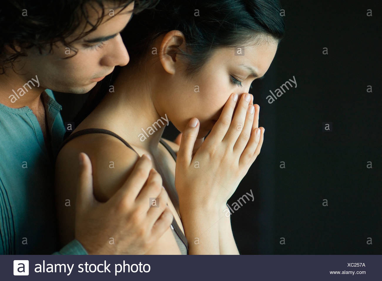 Young couple together, man consoling woman Stock Photo