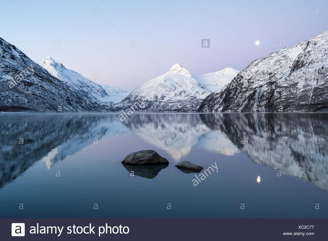 Moon and Portage Lake at twilight, Portage Valley, Alaska, USA - Stock Image