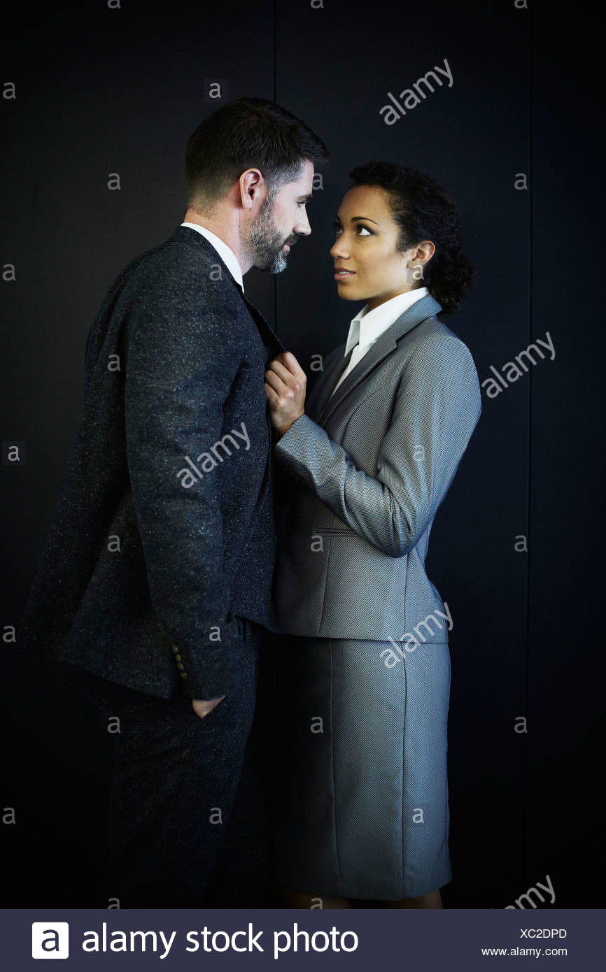 Portrait of couple in business clothing - Stock Image