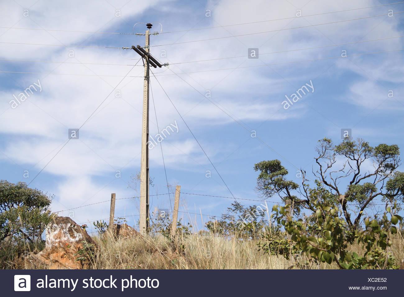 Post, wires, Highway MGC 354, 2016, Lavras, Minas Gerais, Brazil. - Stock Image
