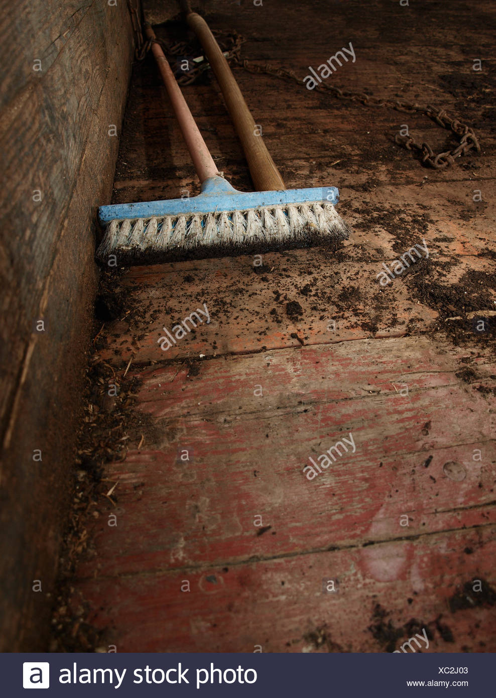 Dirty Broom Cleaning Floor - Stock Image