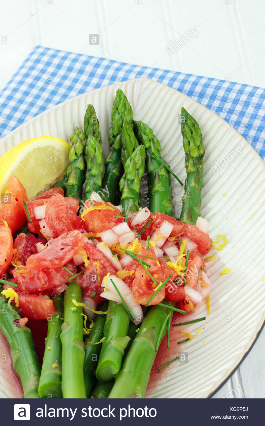 Freshly picked asparagus steamed and served with a tomato and raspberry vinaigrette. Stock Photo