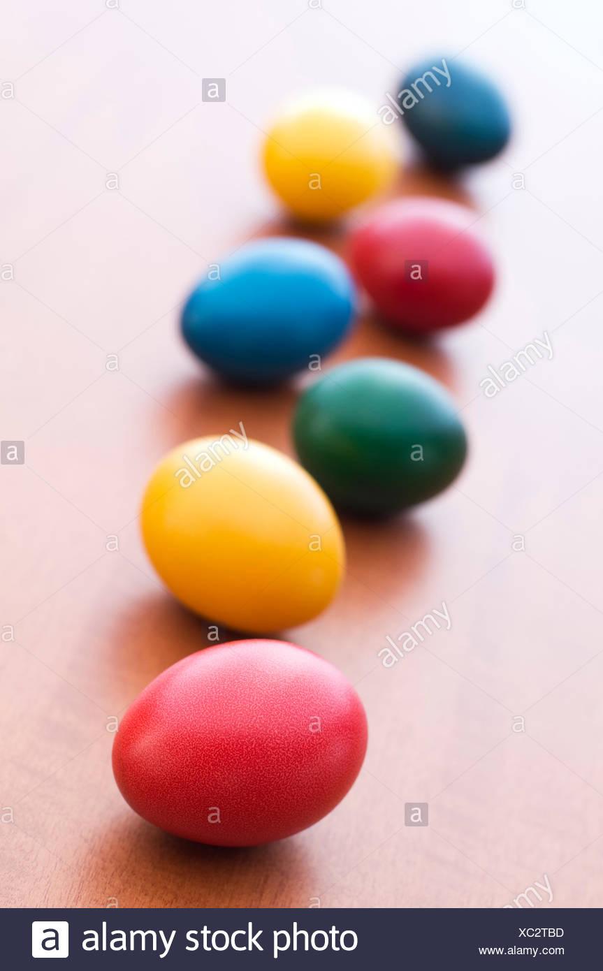 easter egg food aliment colour celebrate reveling revels celebrates easter spring bouncing bounces hop skipping frisks jumping - Stock Image