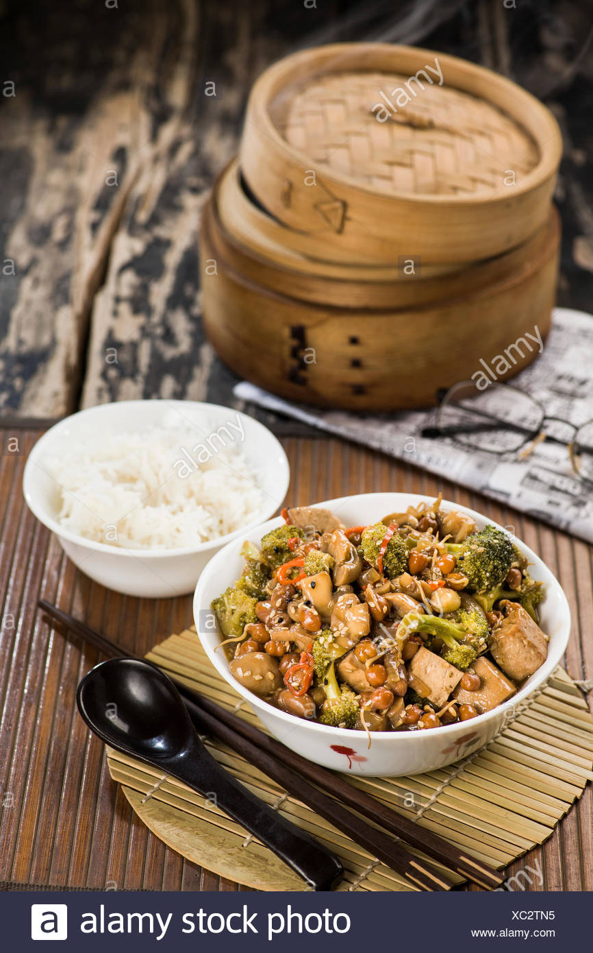 stir fried vegetables in a chinese wok - Stock Image