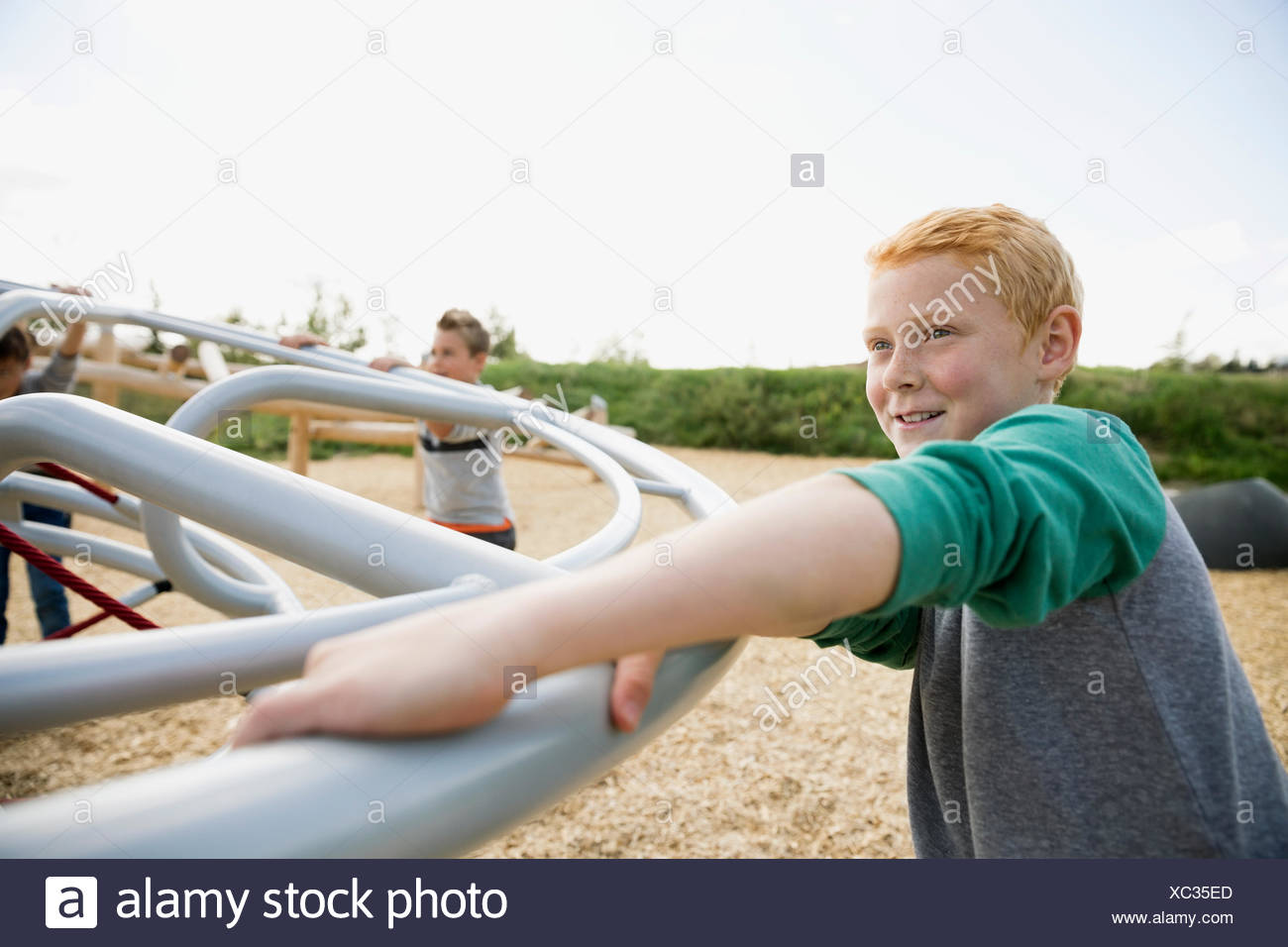 Boy playing with friends at playground - Stock Image