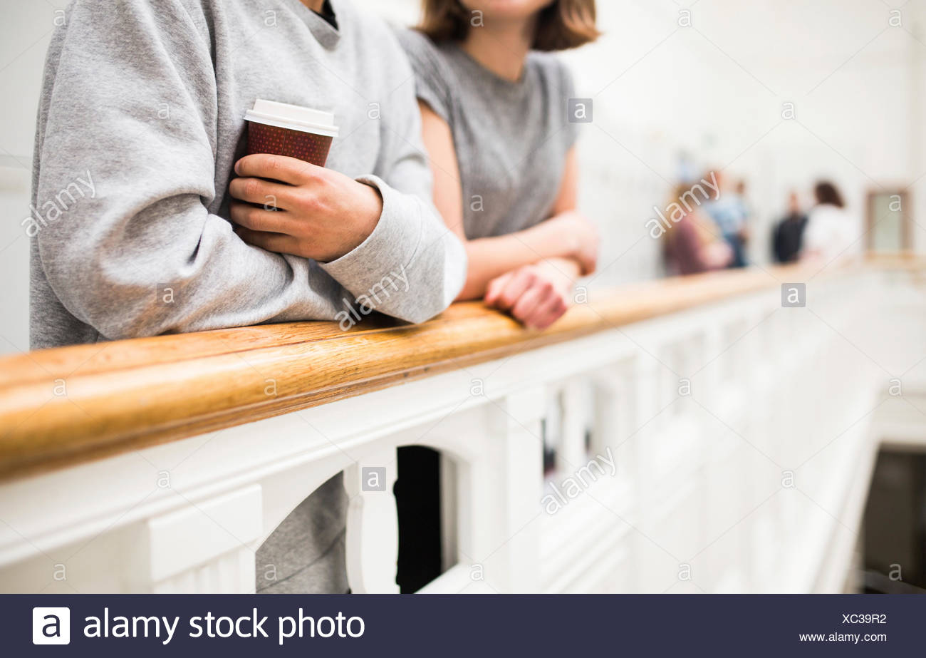 Two students (16-17) by railing - Stock Image