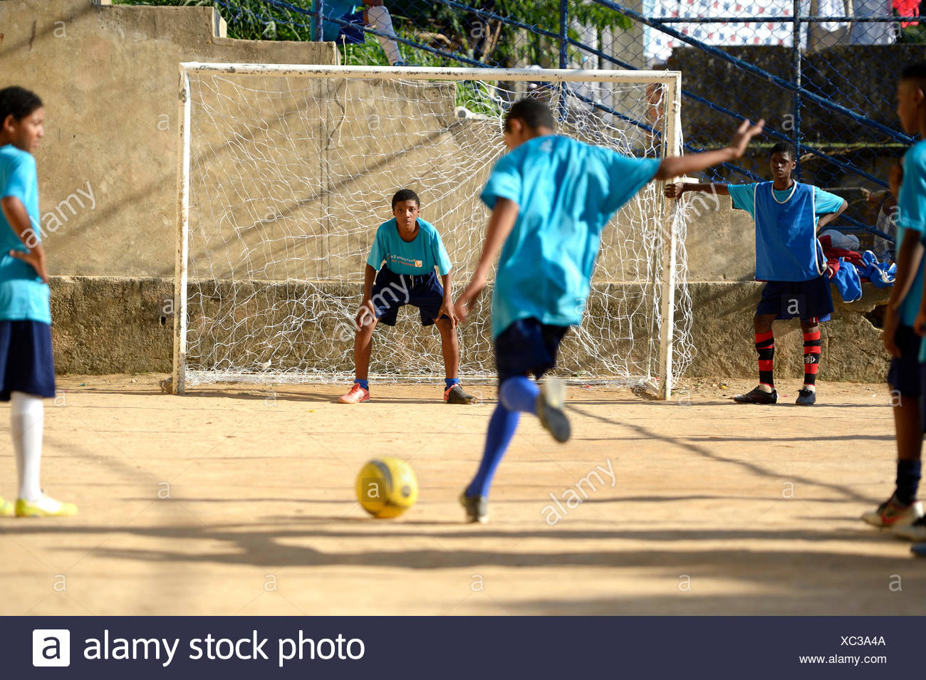 Penalty, soccer tournament on the football ground of the Guararape favela, Rio de Janeiro, Brazil - Stock Image