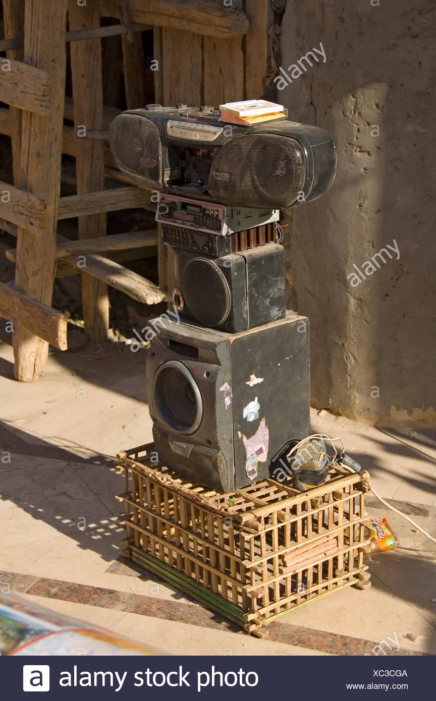 Dusty hi-fi equipment on a market, Aswan, Egypt, Africa - Stock Image