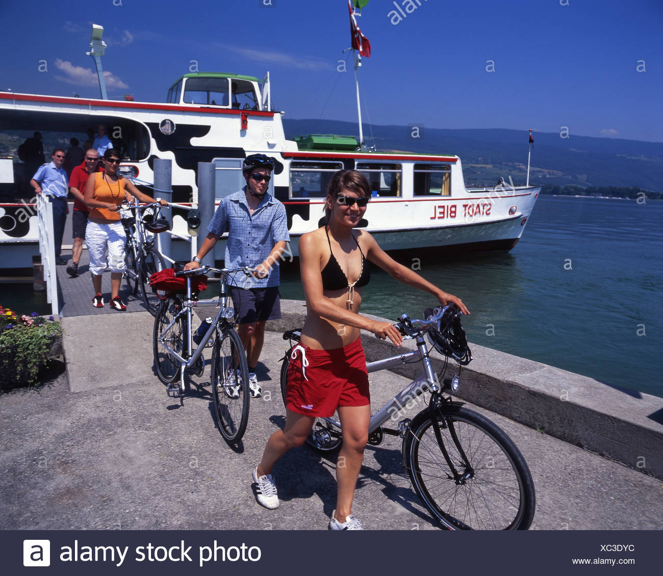 Canton Bern bicycle Bielersee Lake Biel bike canton Erlach excursion group lake lakes passengers scenery - Stock Image