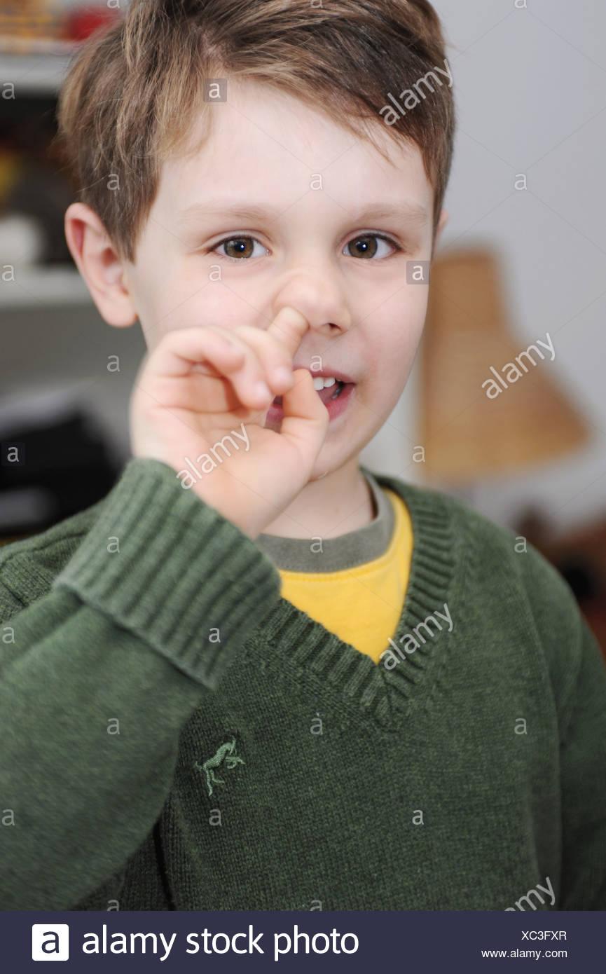 Boy picking his nose - Stock Image