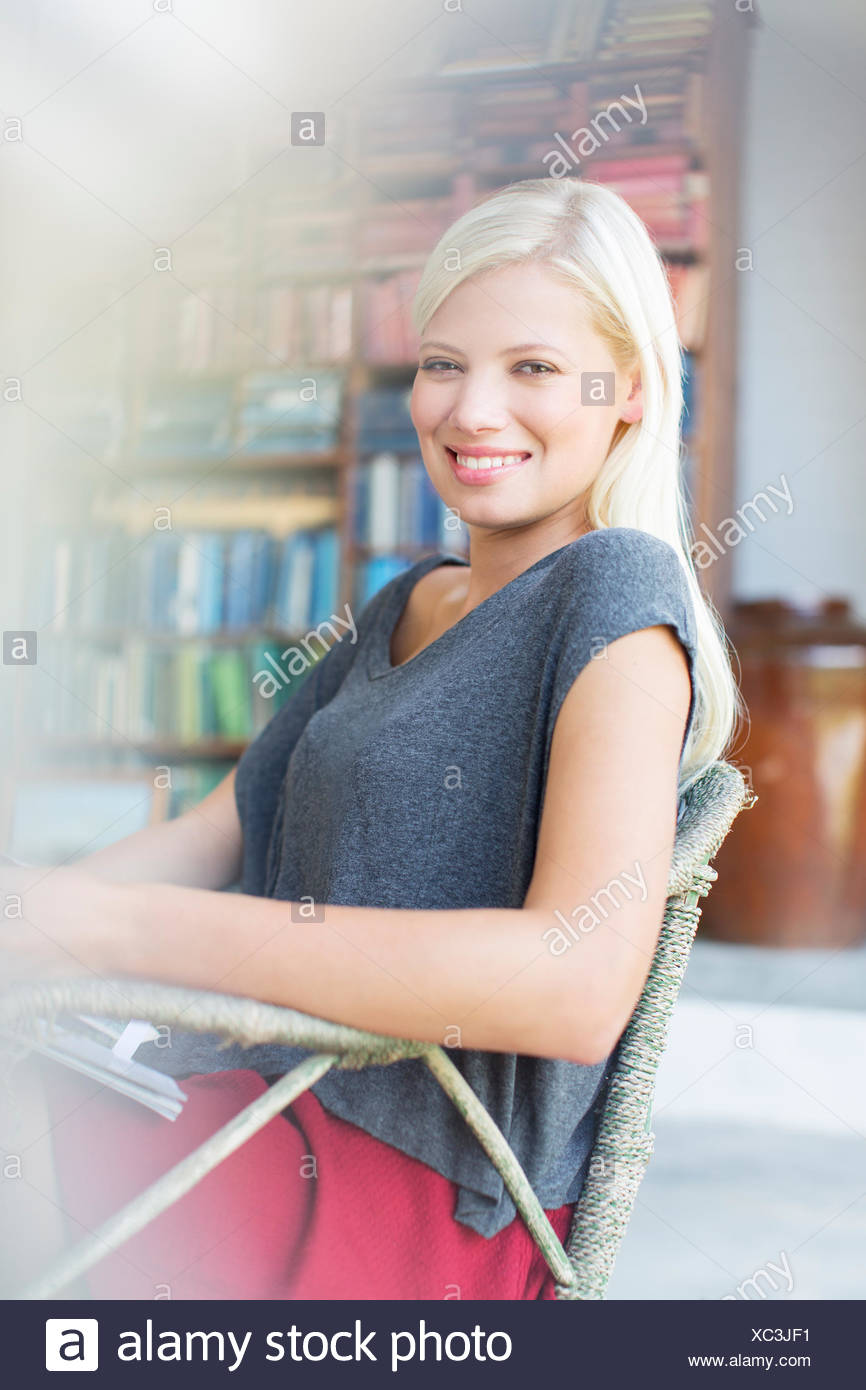 Woman smiling in armchair Stock Photo
