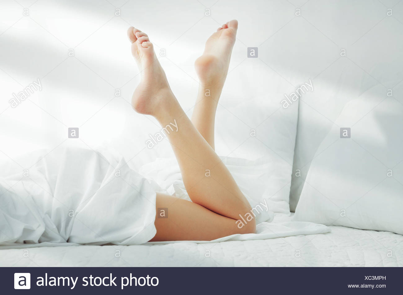 Woman on the bed - Stock Image