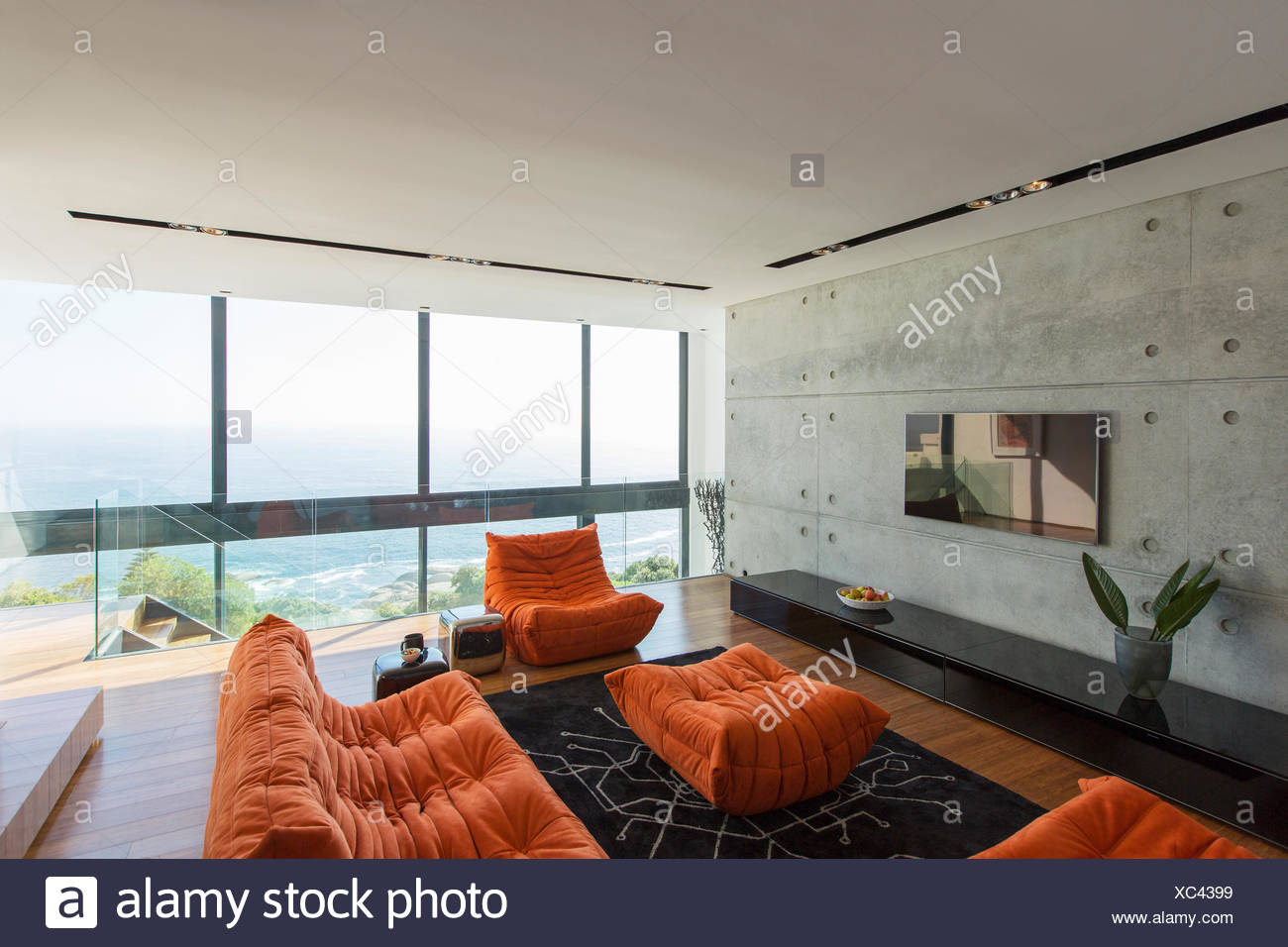 Sofas and ottoman in modern living room - Stock Image