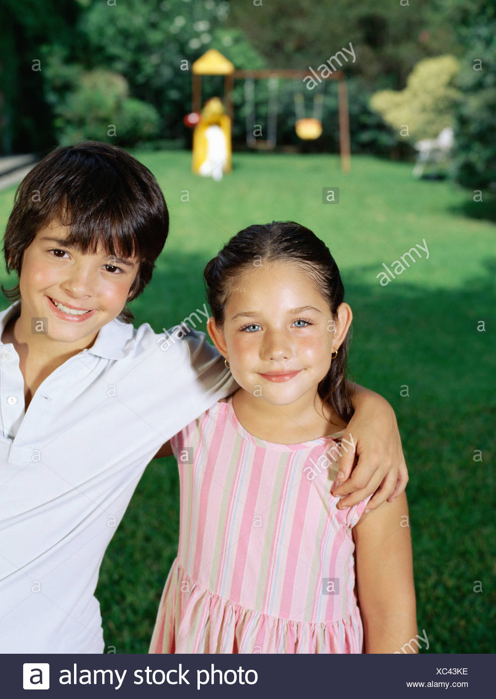 Brother and sister in the garden - Stock Image
