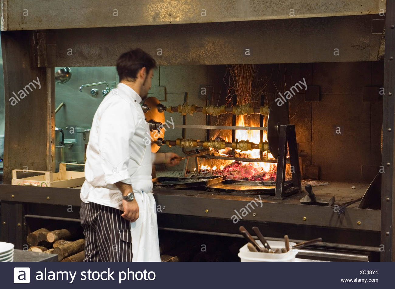 Chef at the grill in the Cibreo top class restaurant, Florence, Tuscany, Italy, Europe - Stock Image