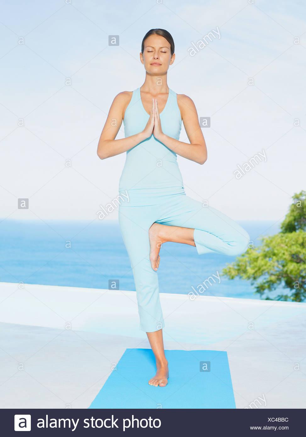 Woman doing yoga - Stock Image