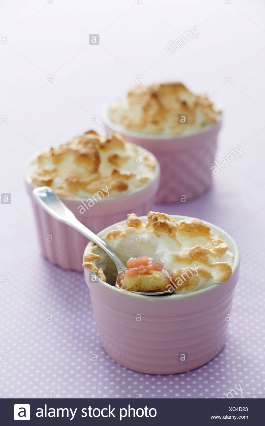 Dish of meringue puddings - Stock Image