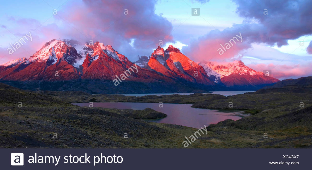 scenery mountains mood dusk twilight afterglow lake Parque Nacional national park Torres del Paine view fro - Stock Image