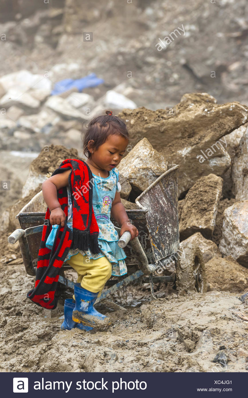 Nepalese mother and baby stock photos nepalese mother and baby little nepalese girl stays with her mother as she works at a construction site on rohtang ccuart Images