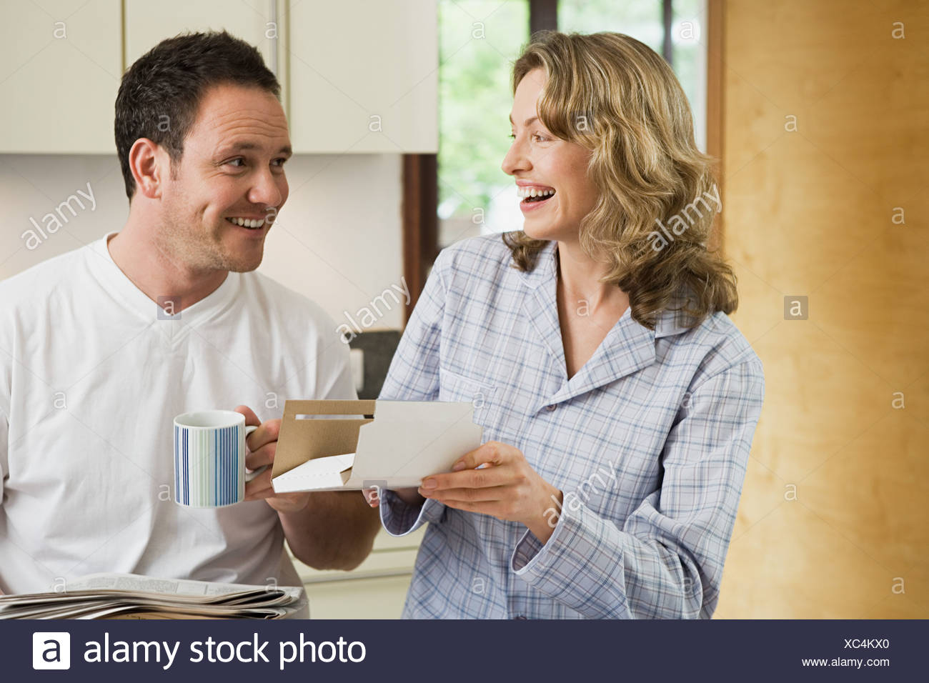 Couple with post in kitchen - Stock Image