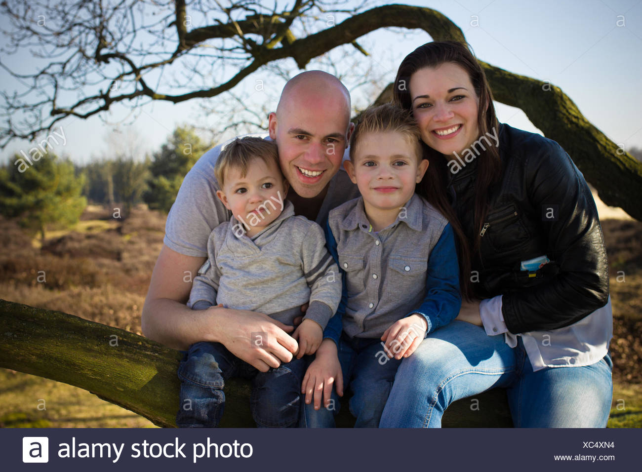 Family portrait outdoors - Stock Image