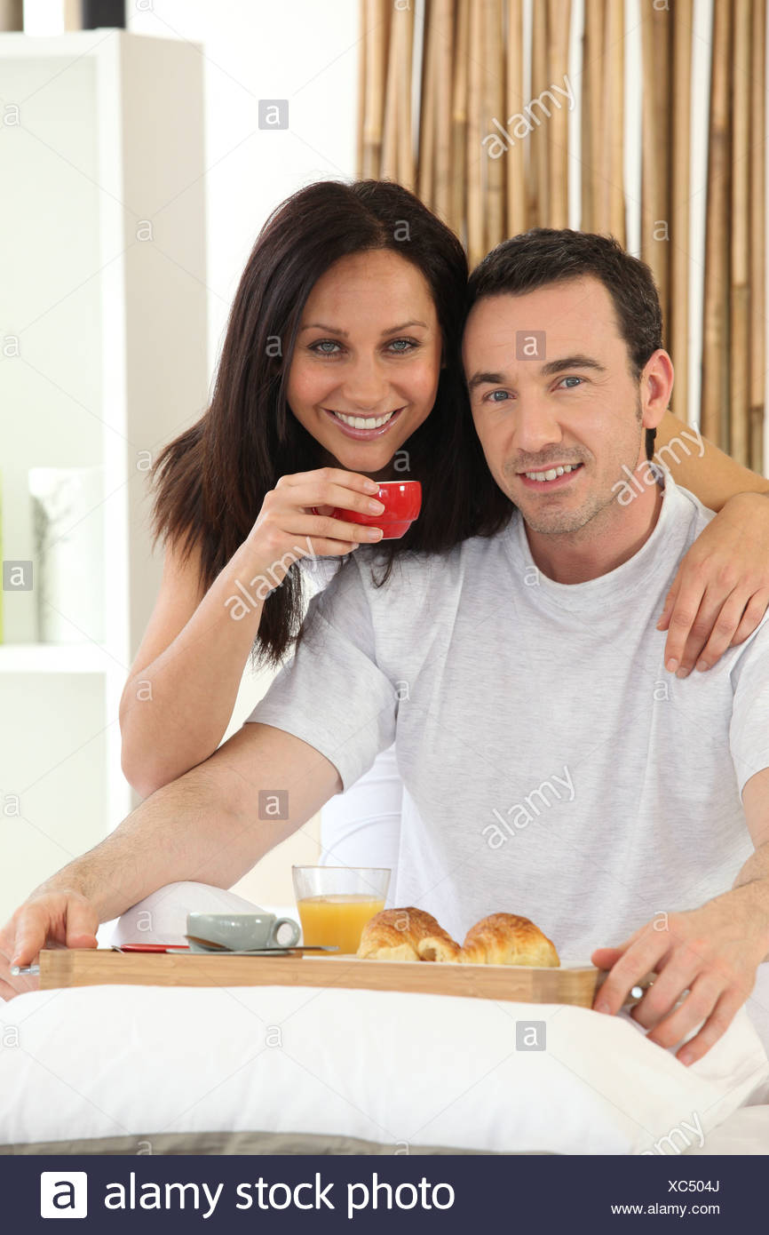 Couple having breakfast in bed Stock Photo