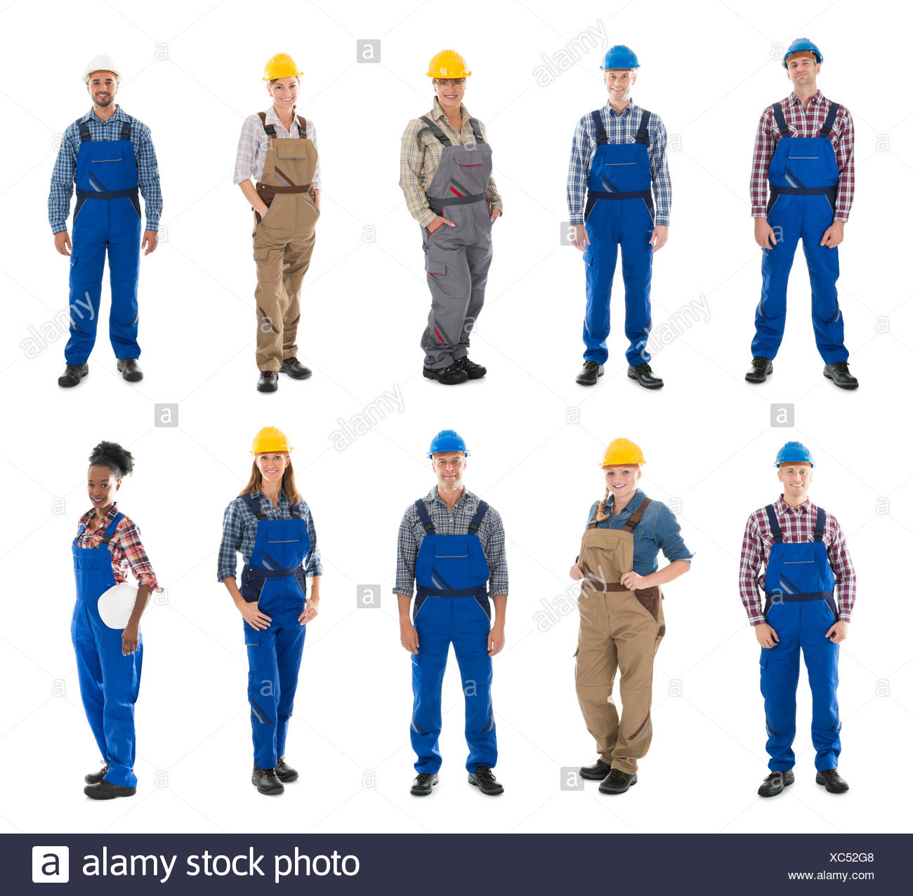 Portrait Of Confident Male Carpenters Standing In Row - Stock Image