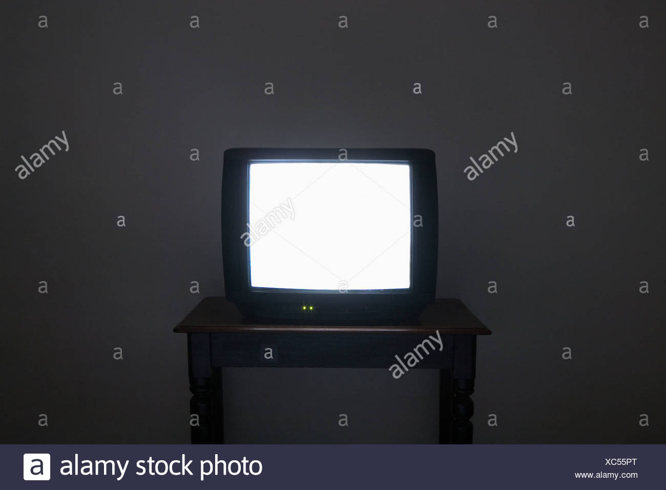 Illuminated television screen - Stock Image