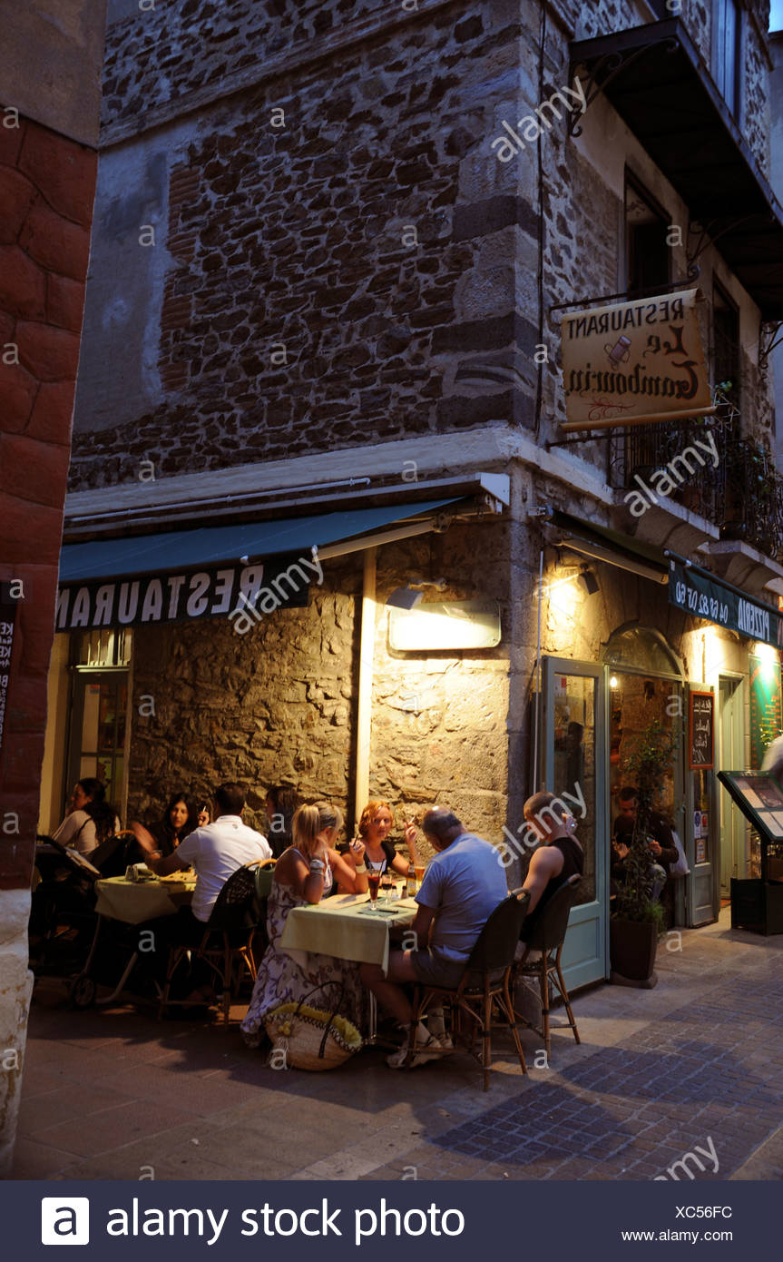 FRENCH RESTAURANT AT NIGHT - Stock Image