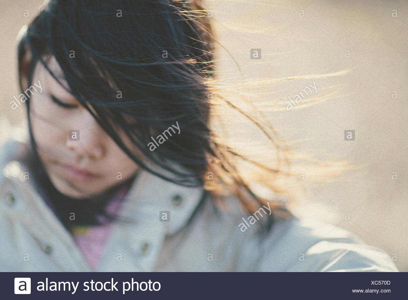 Girl (8-9) portrait on windy day - Stock Image