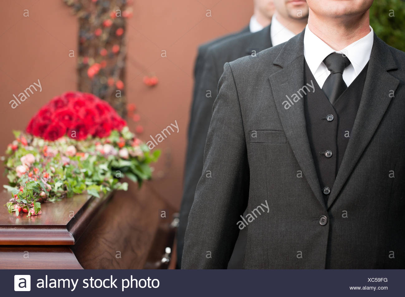 funeral with coffin - Stock Image