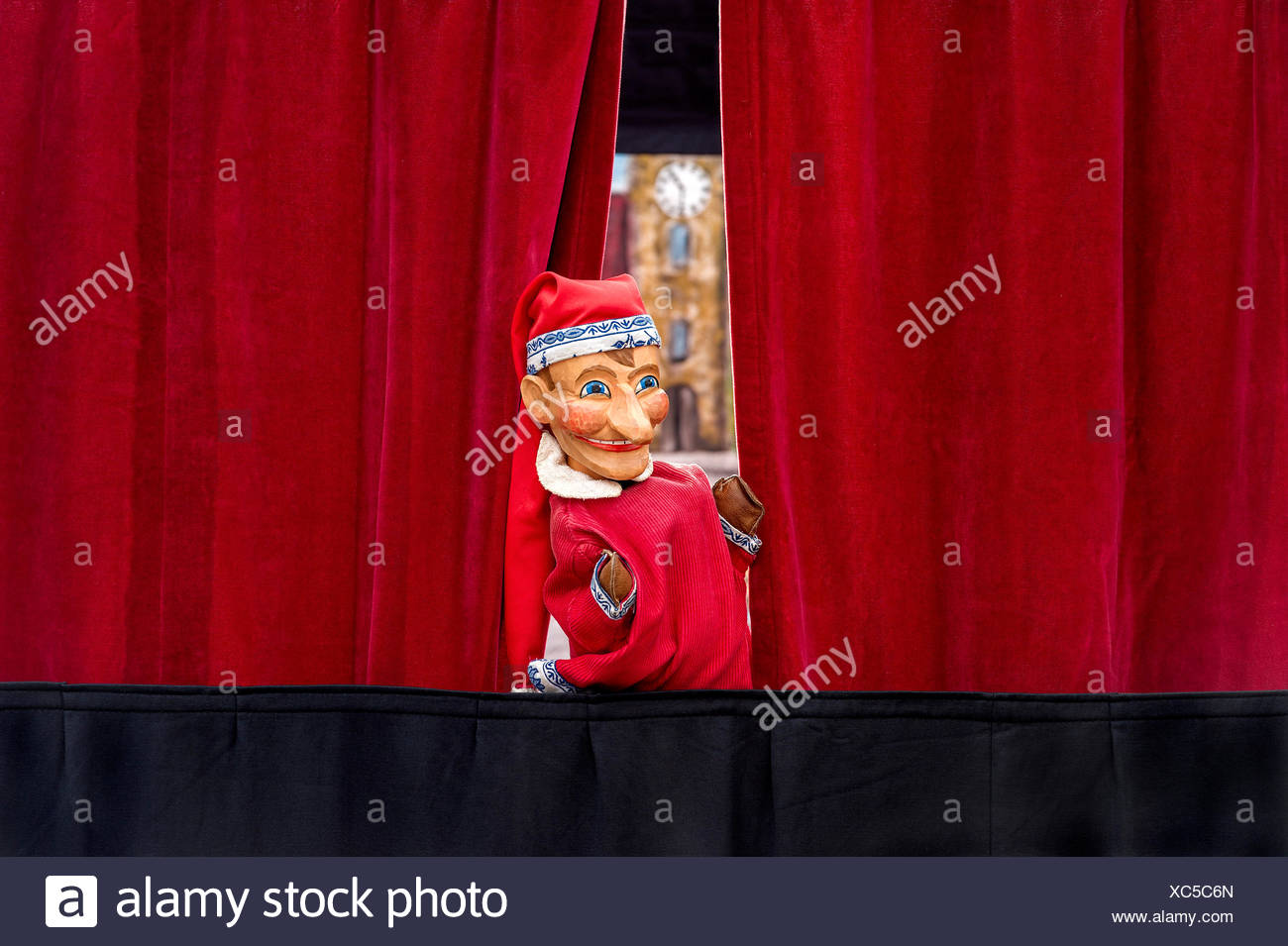Puppet looking through curtain, puppet theater, Upper Bavaria, Bavaria, Germany - Stock Image