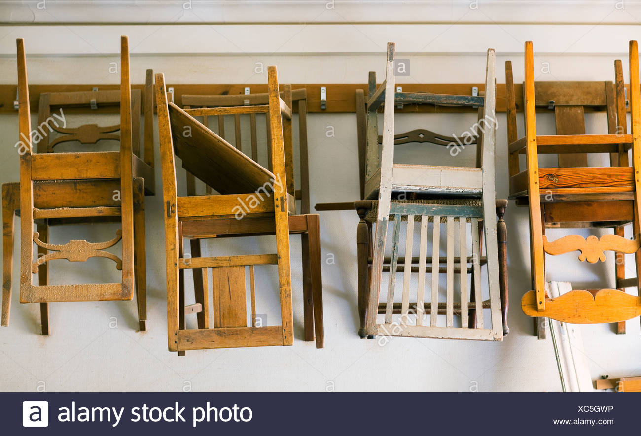 Chairs For Restoration Hanging On A Wall Stock Photo Alamy
