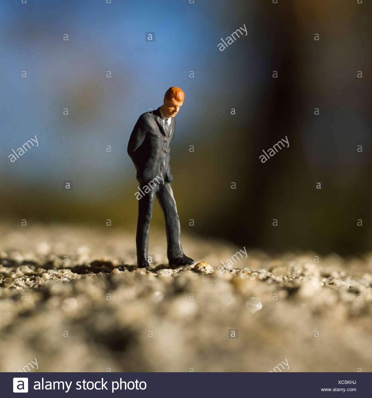 Solitary male figure alone walking - Stock Image
