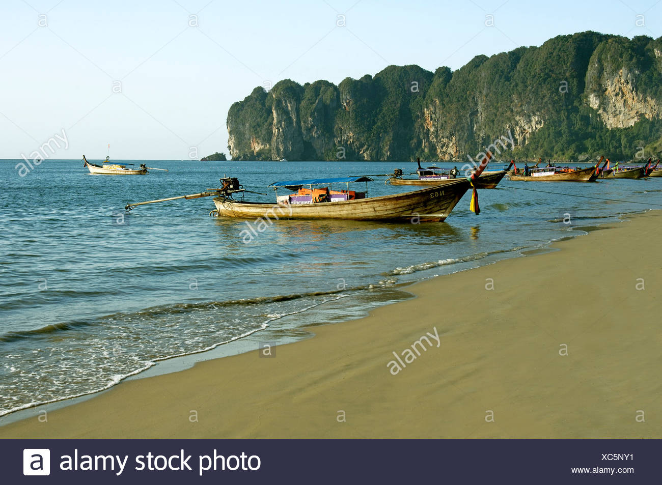 Boat on Krabi beach at Thailand ; South East Asia - Stock Image