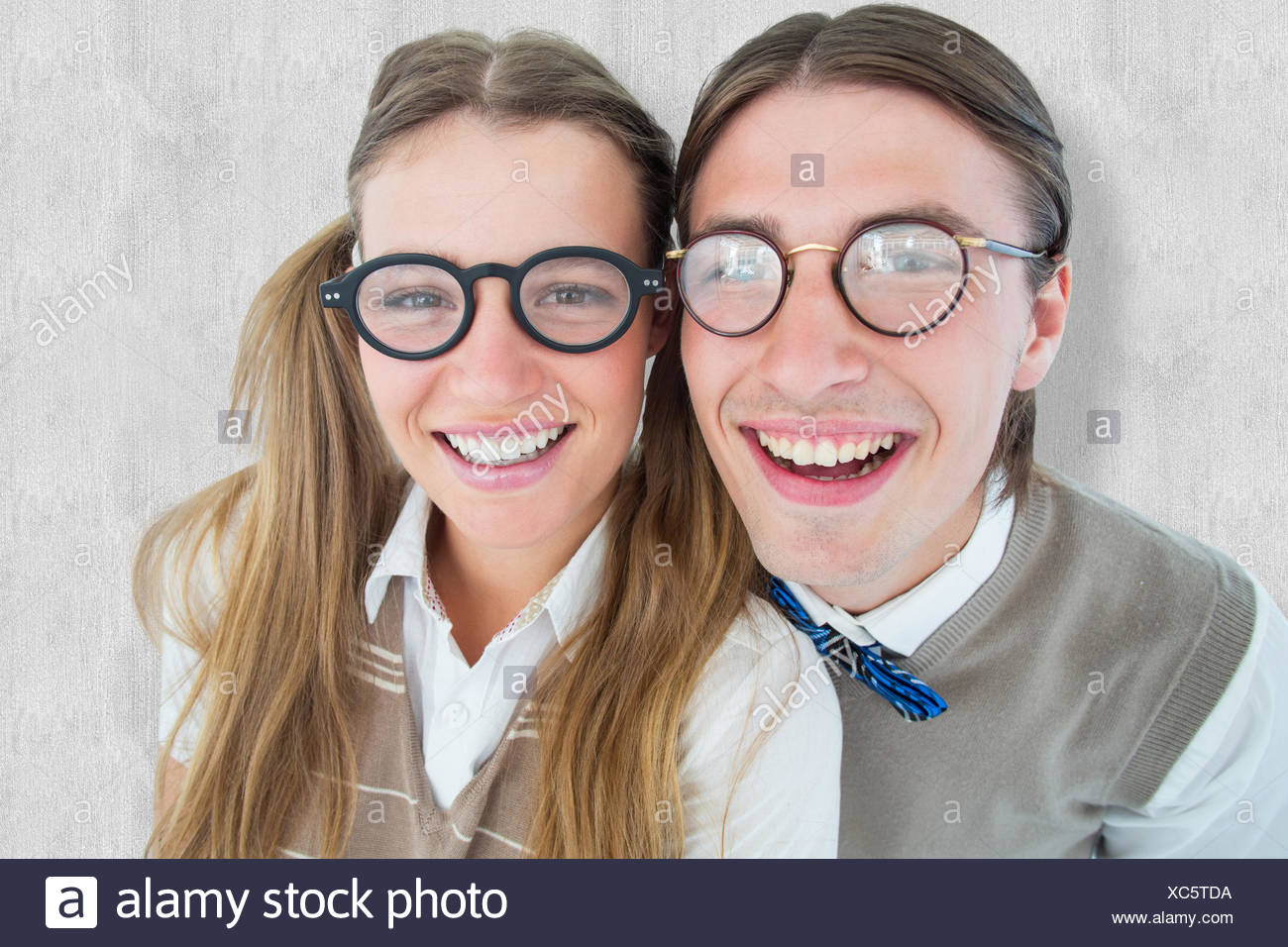 Composite image of geeky hipsters smiling at camera Stock Photo